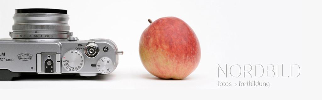 Kamera, Apfel und Wasserzeichen aus dem Firmenloge der Nordbild GmbH erstellt